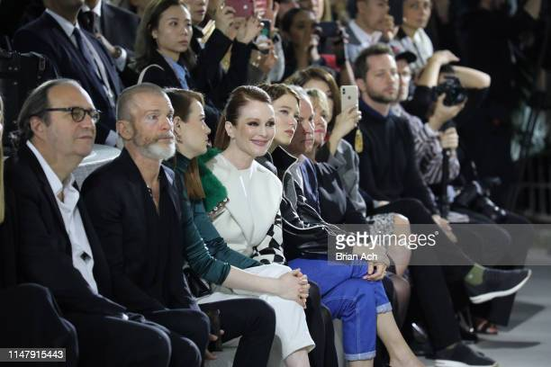 Emma Stone, Julianne Moore, and Lea Seydoux attend the Louis Vuitton Cruise 2020 Fashion Show at JFK Airport on May 08, 2019 in New York City.