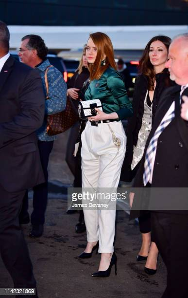 Emma Stone leaves the Louis Vuitton Cruise 2020 Fashion Show at JFK Airport on May 8, 2019 in New York City.
