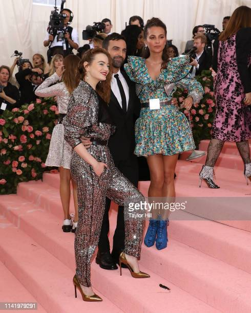 Emma Stone Nicolas Ghesquiere and Alicia Vikander attend the 2019 Met Gala celebrating Camp Notes on Fashion at The Metropolitan Museum of Art on May...