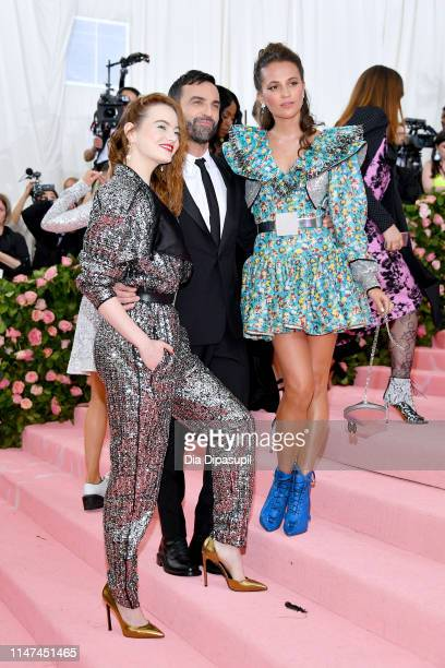 Emma Stone Nicolas Ghesquière and Alicia Vikander attend The 2019 Met Gala Celebrating Camp Notes on Fashion at Metropolitan Museum of Art on May 06...
