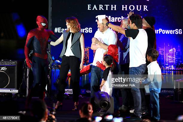Emma Stone of The Amazing SpiderMan 2 greets SpiderMan as he joins the stage for the Earth Hour KickOff with SpiderMan The First Super Hero...