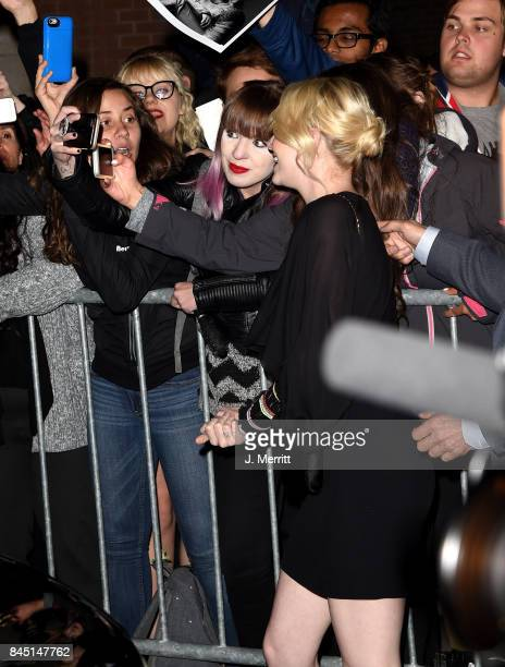 Emma Stone poses for photos with fans as she attends The Hollywood Foreign Press Association and InStyle's annual celebrations of the 2017 Toronto...