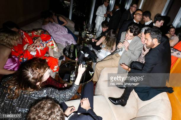 Emma Stone takes a photo of Mark Ronson Baz Luhrmann and Justin Theroux at the Met Gala Boom Boom Afterparty at Top of the Standard on May 6 2019 in...