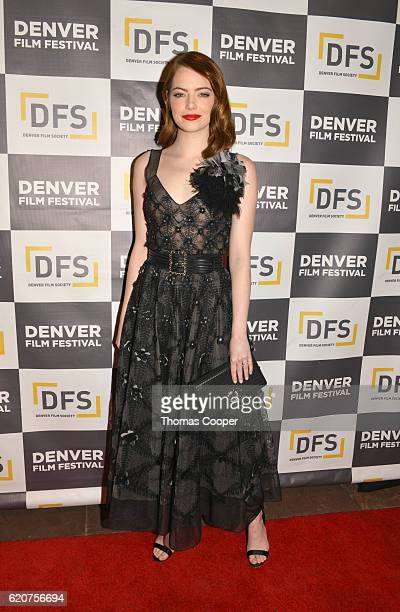 Emma Stone wearing a dress by Chanel attends the red carpet premiere of 'La La Land' at the 39th Denver Film Festival at The Ellie Caulkins Opera...