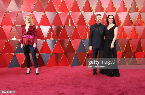 Emma Stone Willem Dafoe and Giada Colagrande attend the 90th Annual Academy Awards at Hollywood Highland Center on March 4 2018 in Hollywood...