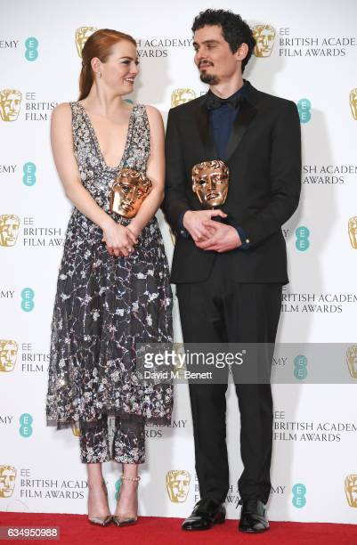 "Emma Stone, winner of the Best Actress Award for ""La La Land"", and Damien Chazelle, winner of Best Director for ""La La Land"", poses in the winners..."