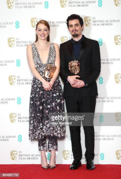 Emma Stone winner of the Best Actress Award for 'La La Land' and Damien Chazelle winner of Best Director for 'La La Land' pose in the winners room at...