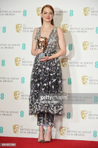 Emma Stone winner of the Best Actress award for 'La La Land' poses in the winners room at the 70th EE British Academy Film Awards at Royal Albert...