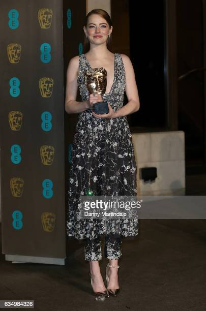 Emma Stone with her BAFTA attends the official after party for the 70th EE British Academy Film Awards at The Grosvenor House Hotel on February 12...