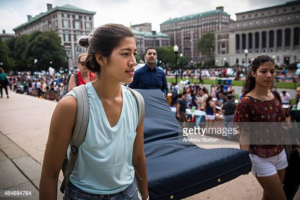 Emma Sulkowicz a senior visual arts student at Columbia University carries a mattress with the help of three strangers who met her moments before in...