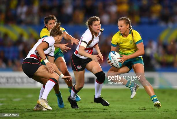 Emma Sykes of Australia takes on Emily Scott of England during the Rugby Sevens Women's Pool B match between Australia and England on day nine of the...