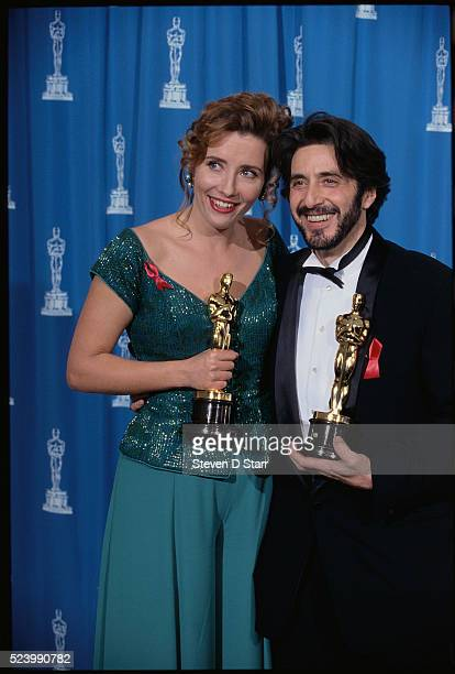 Emma Thompson and Al Pacino hold their Oscars at the 65th Academy Awards in Los Angeles Thompson won Best Actress for her role in Howards End and...