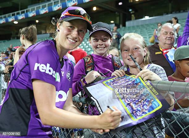 Emma Thompson of the Hurricanes signs autographs for supporters in the crowd during the Women's Big Bash League match between the Sydney Thunder and...