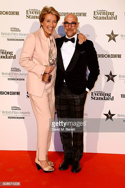 Emma Thompson winner of the Comedy Award for 'The Legend Of Barney Thomson' and presenter Stanley Tucci pose in front of the Winners Boards at the...