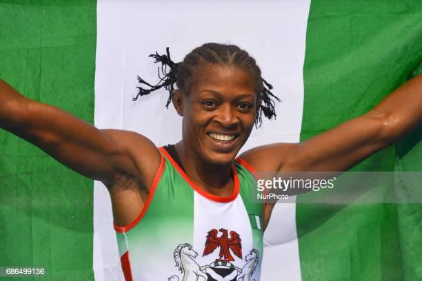 Emma Tissina of Kazakhstan celebrates after winning against Folasadered Adekuoroye Odunayo of Nigeria in the Women's Freestyle 55kg Wrestling...