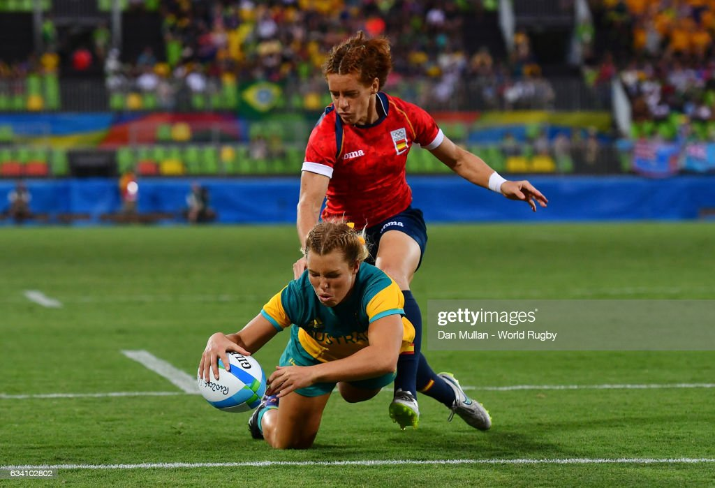 Emma Tonegato of Australia dives over for a try during the Women's Rugby Sevens Quarter Final match between Australia and Spain on Day 2 of the 2016 Rio Olympic Games at Deodoro Stadium on August 7, 2016 in Rio de Janeiro, Brazil.