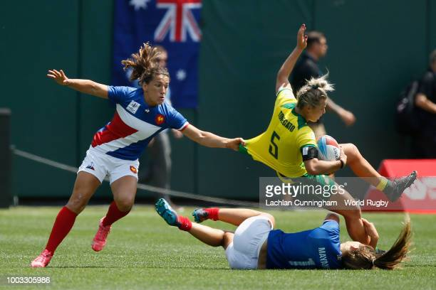 Emma Tonegato of Australia is tackled by Marjorie Mayans and Fanny Horta of France during their semi final on day two of the Rugby World Cup Sevens...