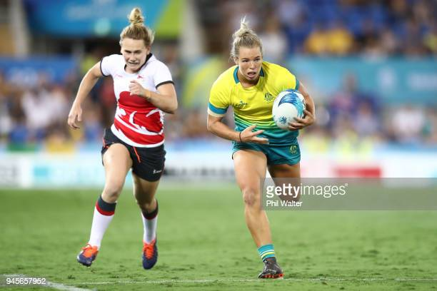 Emma Tonegato of Australia runs in for a try during in the match between Australia and England during Rugby Sevens on day nine of the Gold Coast 2018...