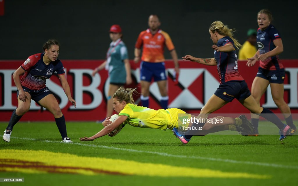 Emma Tonegato of Australia scores a try during the match between Australia and Russia on Day One of the Emirates Dubai Rugby Sevens - HSBC Sevens World Series at The Sevens Stadium on November 30, 2017 in Dubai, United Arab Emirates.