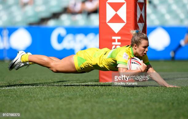 Emma Tonegato of Australia scores a try in the quarter final match against Spain during day two of the 2018 Sydney Sevens at Allianz Stadium on...