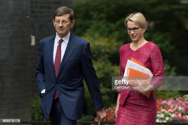 Emma Walmsley chief executive officer of GlaxoSmithKline and Vittorio Colao chief executive officer of Vodafone Group arrive in Downing Street to...