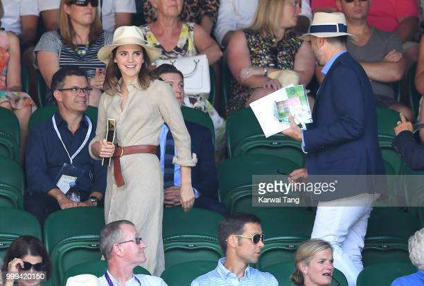 Emma Watson and John Vosler attend the men's singles final on day thirteen of the Wimbledon Tennis Championships at the All England Lawn Tennis and...