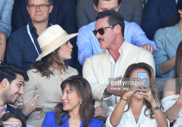 Emma Watson and Luke Evans attend the men's single final on day thirteen of the Wimbledon Tennis Championships at the All England Lawn Tennis and...