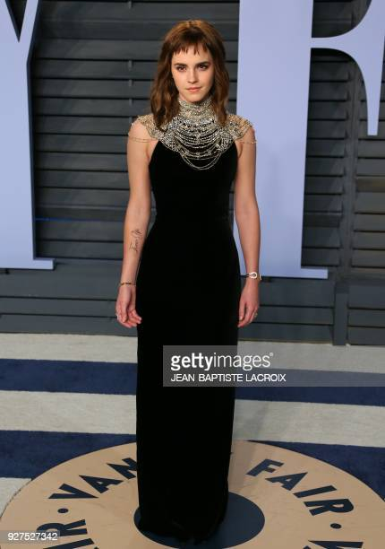 Emma Watson attends the 2018 Vanity Fair Oscar Party following the 90th Academy Awards at The Wallis Annenberg Center for the Performing Arts in...