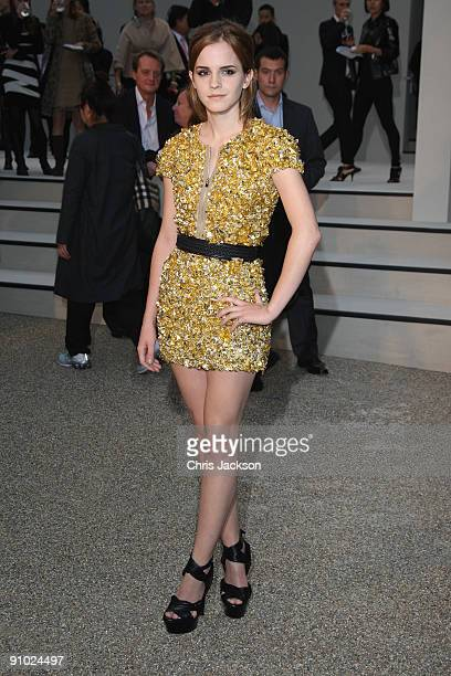 Emma Watson dressed in Burberry arrives at the Burberry Prorsum Spring/Summer 2010 Show at Rootstein Hopkins Parade Ground during London Fashion Week...