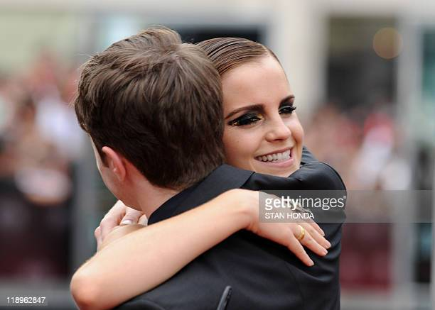 """Emma Watson gives a hug to Daniel Radcliffe as they arrive for the North American premiere of """"Harry Potter and the Deathly Hallows – Part 2"""" July 11..."""
