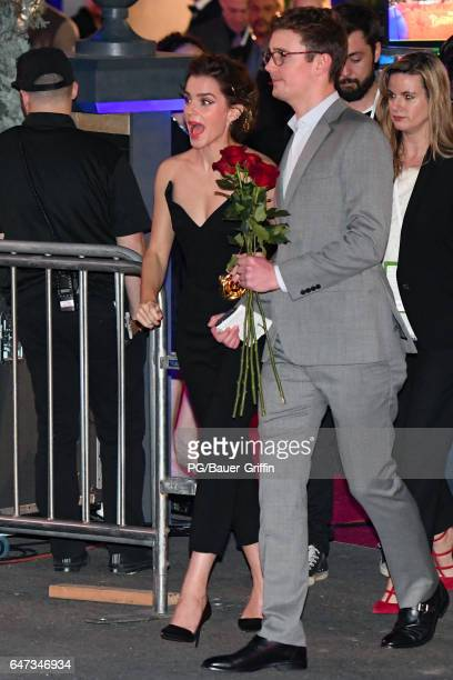 """Emma Watson is seen signing autographs for fans as she arrives at the premiere of """"Beauty and the Beast"""" on March 02, 2017 in Los Angeles, California."""