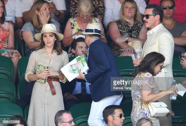 Emma Watson John Vosler and Luke Evans attend the men's singles final on day thirteen of the Wimbledon Tennis Championships at the All England Lawn...