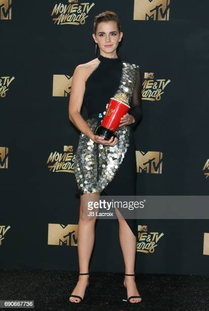 Emma Watson poses in the press room at the 2017 MTV Movie and TV Awards at The Shrine Auditorium on May 7 2017 in Los Angeles California