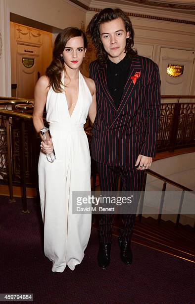 Emma Watson winner of the British Style award and Harry Styles attend the British Fashion Awards at the London Coliseum on December 1 2014 in London...