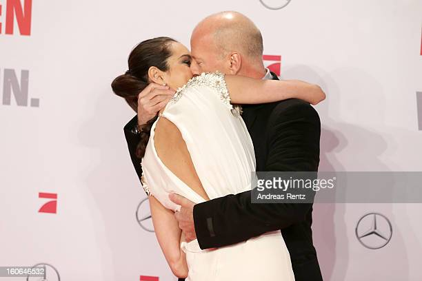 Emma Willis and Bruce Willis attend 'Die Hard - Ein Guter Tag Zum Sterben' Germany Premiere at Cinestar Potsdamer Platz on February 4, 2013 in...