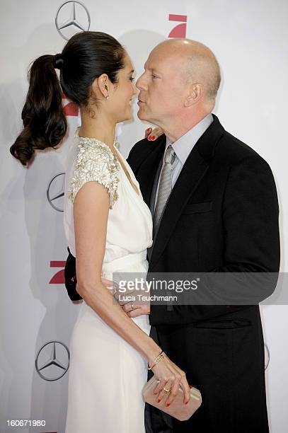 Emma Willis and Bruce Willis attend the premiere of 'Die Hard Ein Guter Tag Zum Sterben' at Sony Center on February 4 2013 in Berlin Germany
