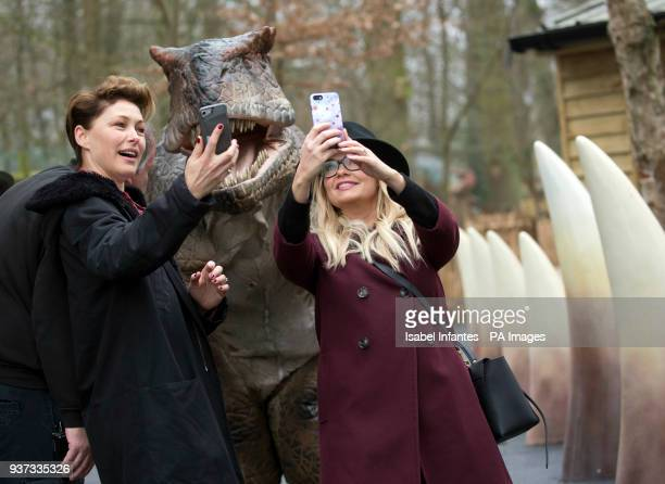 Emma Willis and Emma Bunton take a selfie with a dinosaur during the opening of World of Dinosaurs a brand new attraction at Paradise Wildlife Zoo...