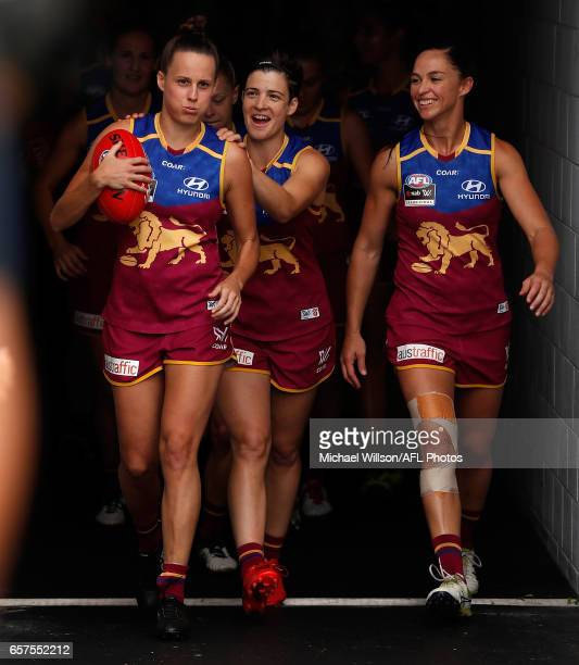 Emma Zielke of the Lions leads her team onto the field during the 2017 AFLW Grand Final match between the Brisbane Lions and the Adelaide Crows at...