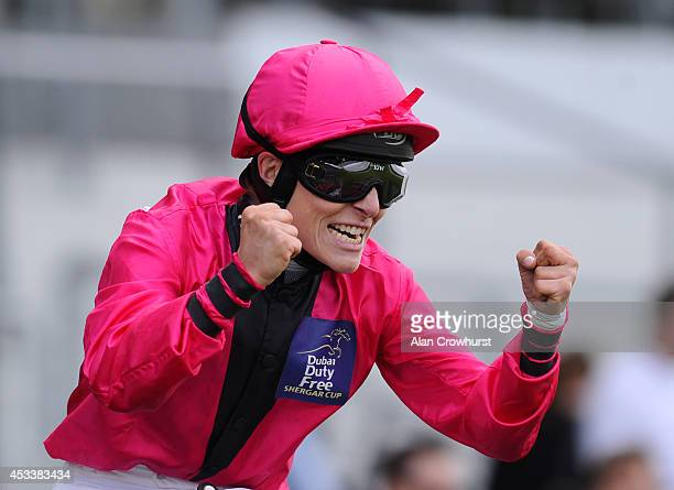 Emma-Jayne Wilson of Canada celebrates after riding Don't Call Me to win The Dubai Duty Free Shergar Cup Mile at Ascot racecourse on August 09, 2014...