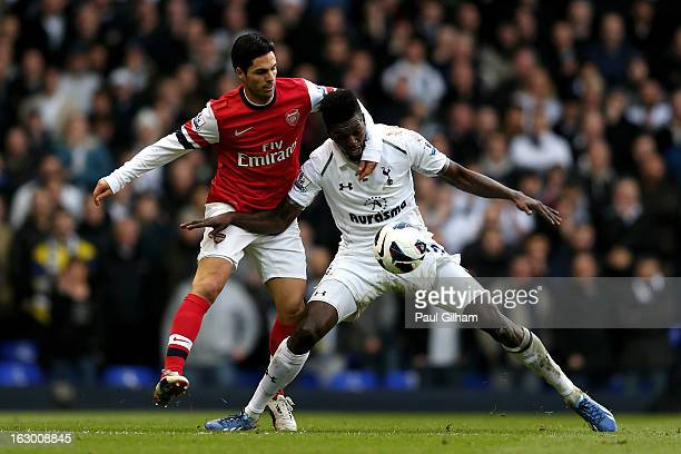 Emmanuel Abebayor of Spurs is challenged by Mikel Arteta of Arsenal during the Barclays Premier League match between Tottenham Hotspur and Arsenal FC...