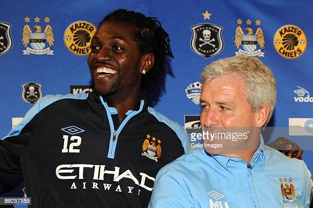 Emmanuel Adebayor and Mark Hughes of Manchester City pose during a joint press conference with he Kaizer Chiefs at Loftus Versfeld Stadium on July 24...