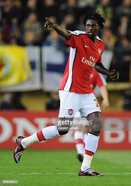 Emmanuel Adebayor of Arsenal celebrates scoring his team's first goal during the UEFA Champions League quarterfinal first leg match between...