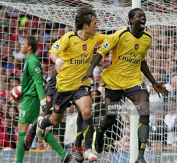Emmanuel Adebayor of Arsenal celebrates scoring the first goal during the Barclays Premiership match between Manchester United and Arsenal at Old...