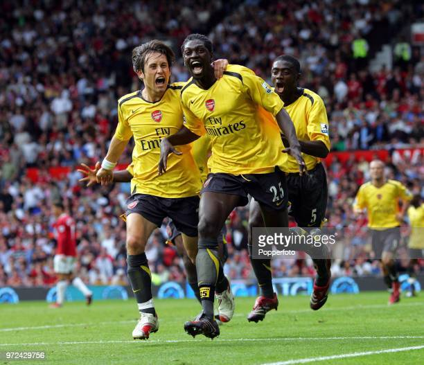 Emmanuel Adebayor of Arsenal celebrates with teammates Tomas Rosicky and Kolo Toure during the Barclays Premiership match between Manchester United...