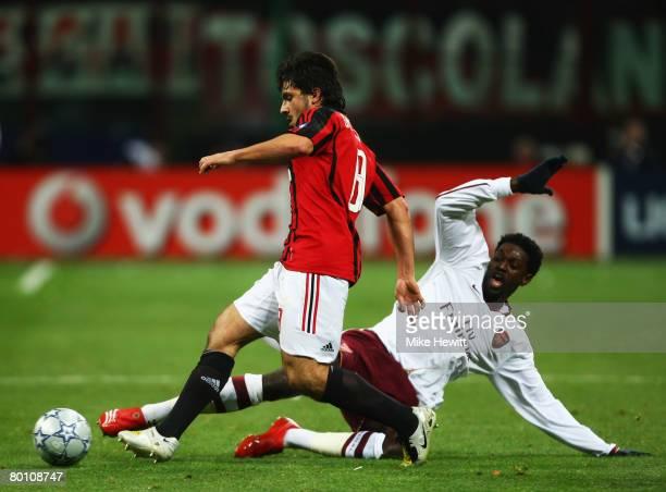 Emmanuel Adebayor of Arsenal challenges Gennaro Gattuso of AC Milan during the UEFA Champions League 1st knockout round 2nd leg match between AC...