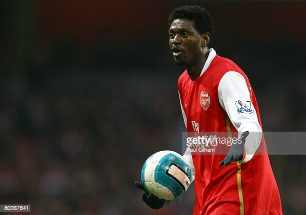 Emmanuel Adebayor of Arsenal contests a decision with the assistant referee during the Barclays Premier League match between Arsenal and...
