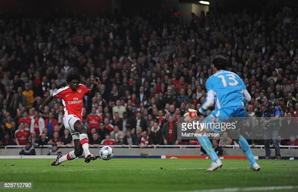 Emmanuel Adebayor of Arsenal scores a goal to make it 2-0 past goalkeeper Diego Lopez of Villarreal