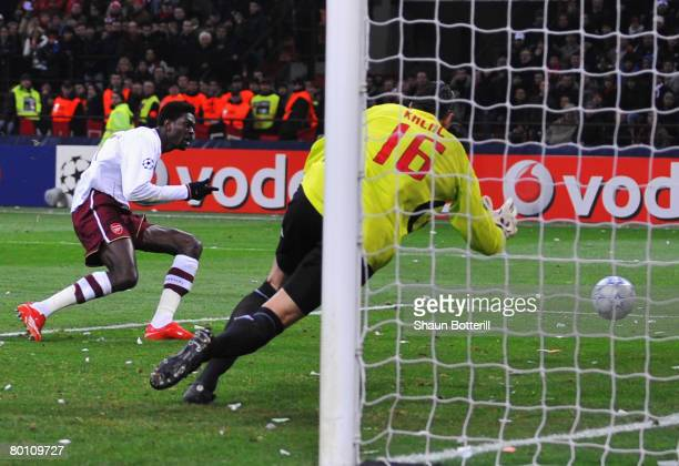 Emmanuel Adebayor of Arsenal scores his teams 2nd goal during the UEFA Champions League 1st knockout round 2nd leg match between AC Milan and Arsenal...