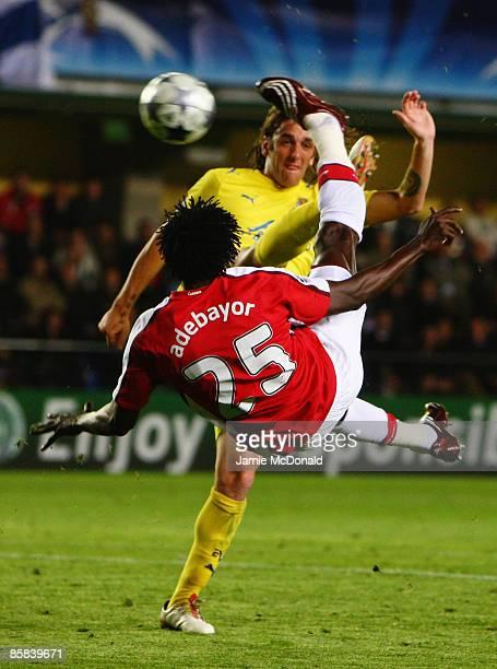 Emmanuel Adebayor of Arsenal scores his team's first goal during the UEFA Champions League quarterfinal first leg match between Villarreal and...