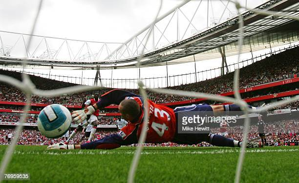 Emmanuel Adebayor of Arsenal scores his third and Arsenals fifth goal from the penalty spot past goalkeeper Stephen Bywater of Derby to score...